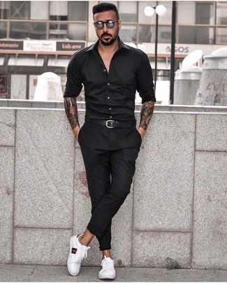 How to wear: black long sleeve shirt, black chinos, white print leather low top sneakers, black leather belt