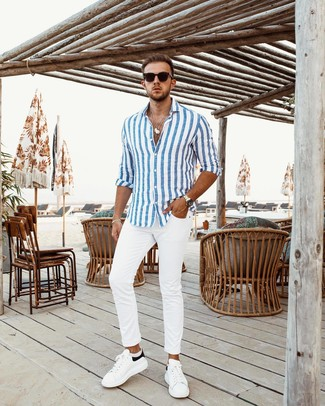 How to Wear a White and Blue Vertical Striped Long Sleeve Shirt For Men: This combo of a white and blue vertical striped long sleeve shirt and white chinos is hard proof that a safe casual ensemble doesn't have to be boring. Introduce white and black leather low top sneakers to this look et voila, the ensemble is complete.
