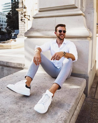 How to Wear a Gold Bracelet For Men: Solid proof that a white long sleeve shirt and a gold bracelet look amazing when you pair them together in a laid-back ensemble. And it's a wonder how a pair of white and black leather low top sneakers can change an outfit.