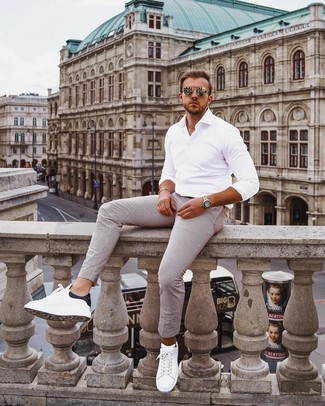 How to Wear Gold Sunglasses For Men: A white long sleeve shirt and gold sunglasses are a modern casual combo that every modern guy should have in his casual collection. And if you wish to easily bump up your look with a pair of shoes, introduce a pair of white and black leather low top sneakers to the mix.