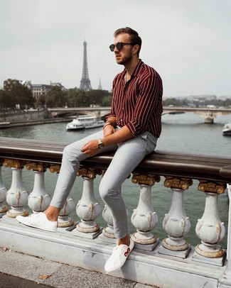 How to wear: burgundy vertical striped long sleeve shirt, grey chinos, white leather low top sneakers, black sunglasses