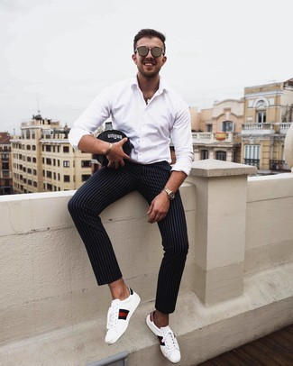 How to wear: white long sleeve shirt, black vertical striped chinos, white print leather low top sneakers, brown sunglasses