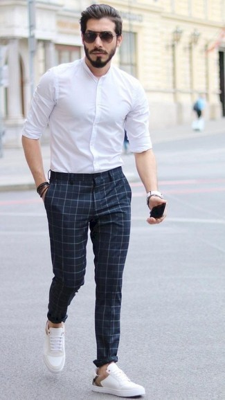 Men's Looks & Outfits: What To Wear In 2020: A white long sleeve shirt and navy check chinos are a nice pairing that will effortlessly take you throughout the day and into the night. When it comes to shoes, complete your ensemble with white leather low top sneakers.