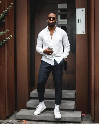 How to Wear White Socks For Men: You'll be amazed at how easy it is for any man to get dressed this way. Just a white long sleeve shirt married with white socks. And if you want to easily step up your ensemble with footwear, why not add a pair of white leather low top sneakers to the equation?