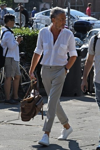 How to Wear a Black Leather Watch After 60 For Men: If you like edgy combinations, then you'll appreciate this pairing of a white linen long sleeve shirt and a black leather watch. Throw in white low top sneakers to completely jazz up the look.