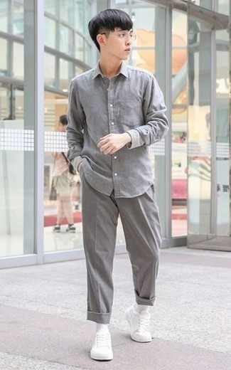 How to Wear a Grey Long Sleeve Shirt For Men: Why not opt for a grey long sleeve shirt and grey chinos? As well as very comfortable, both of these items look awesome when paired together. For something more on the cool and laid-back side to complete this look, complement this ensemble with white leather low top sneakers.