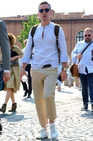 How to Wear a Bracelet For Men: Breathe some fun into your day-to-day arsenal with a light blue linen long sleeve shirt and a bracelet. With shoes, go for something on the smarter end of the spectrum by finishing with a pair of white leather low top sneakers.
