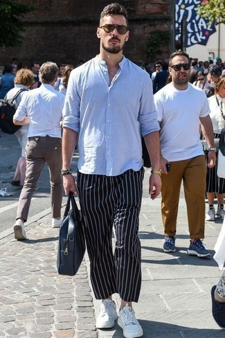 How to Wear Navy Vertical Striped Chinos: A light blue linen long sleeve shirt and navy vertical striped chinos are a cool go-to getup to keep in your menswear arsenal. Now all you need is a pair of white leather low top sneakers.