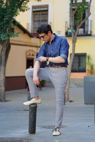 Beige Leather Low Top Sneakers Outfits For Men: This combination of a blue chambray long sleeve shirt and grey chinos will allow you to parade your prowess in menswear styling even on dress-down days. If you wish to easily play down this outfit with one single item, throw beige leather low top sneakers in the mix.