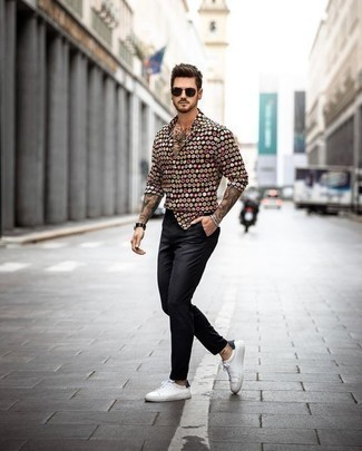 How to Wear White and Black Leather Low Top Sneakers For Men: Try pairing a black print long sleeve shirt with black chinos to achieve new heights in menswear styling. Make white and black leather low top sneakers your footwear choice et voila, this look is complete.
