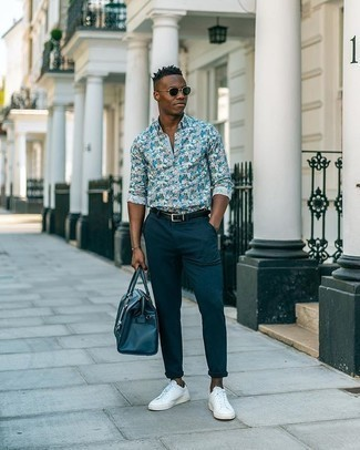 Blue Floral Long Sleeve Shirt Outfits For Men: For a casually dapper getup, team a blue floral long sleeve shirt with navy chinos — these two pieces play nicely together. Complement your outfit with white and black canvas low top sneakers et voila, the look is complete.