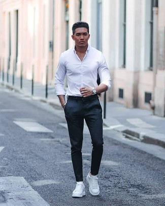 White Leather Low Top Sneakers Outfits For Men: If you're seeking to take your casual look to a new height, go for a white long sleeve shirt and navy chinos. For a more casual twist, introduce a pair of white leather low top sneakers to the mix.