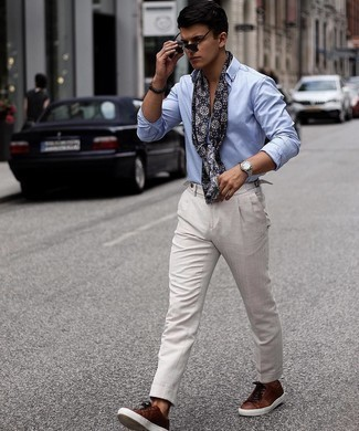 500+ Spring Outfits For Men: The versatility of a light blue long sleeve shirt and grey chinos ensures they will be on regular rotation. Complete your ensemble with a pair of dark brown leather low top sneakers to make a standard ensemble feel suddenly fresh. So if you're scouting for an outfit that's stylish but also feels totally spring-ready, this one fits the task well.