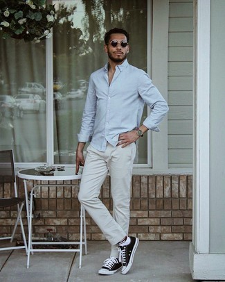 White No Show Socks Outfits For Men: For a neat and relaxed outfit, wear a light blue long sleeve shirt with white no show socks — these items play perfectly together. Unimpressed with this look? Introduce a pair of black and white canvas low top sneakers to jazz things up.