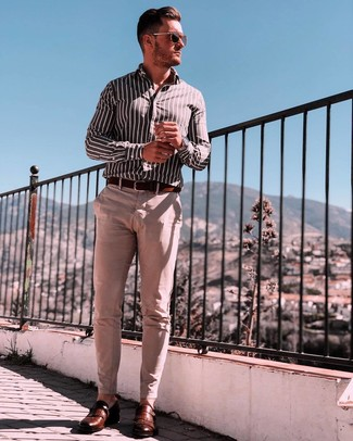 How to wear: black and white vertical striped long sleeve shirt, beige chinos, brown leather monks, dark brown leather belt