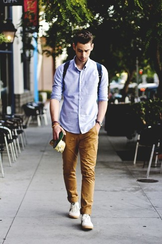 How to wear: light blue long sleeve shirt, khaki chinos, white plimsolls, navy canvas backpack