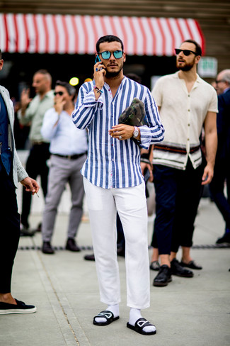 How to wear: white and blue vertical striped long sleeve shirt, white chinos, black and white print leather sandals, olive camouflage canvas zip pouch