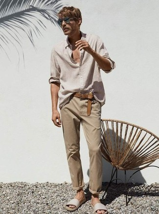 Men's Looks & Outfits: What To Wear In 2020: Why not rock a beige linen long sleeve shirt with khaki chinos? As well as super practical, both pieces look amazing when married together. Introduce beige leather sandals to the mix to have some fun with things.