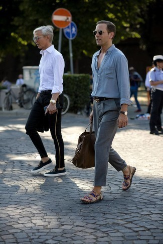 Black Watch Outfits For Men: This combination of a grey long sleeve shirt and a black watch is solid proof that a pared down off-duty look can still look really interesting. Add multi colored canvas sandals to the equation to keep the outfit fresh.