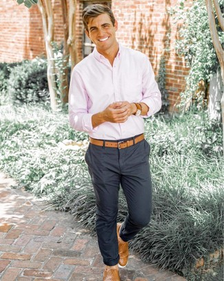 How to wear: pink long sleeve shirt, charcoal chinos, tan woven leather slip-on sneakers, tan leather belt