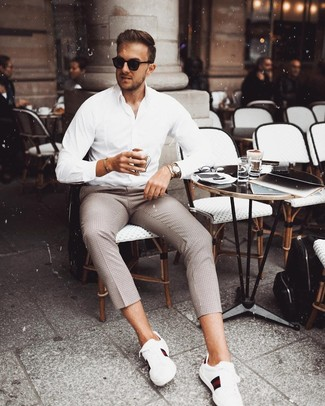 How to wear: white long sleeve shirt, brown check chinos, black sunglasses, silver watch