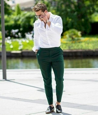 How to Wear Black Leather Tassel Loafers: This combination of a white long sleeve shirt and dark green chinos speaks versatility and stylish comfort. A pair of black leather tassel loafers immediately smartens up any ensemble.