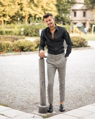 How to Wear a Black Long Sleeve Shirt For Men: A black long sleeve shirt and grey plaid chinos? This is easily a wearable outfit that any man could sport on a daily basis. If you wish to immediately step up this look with one item, why not complement your ensemble with black leather tassel loafers?