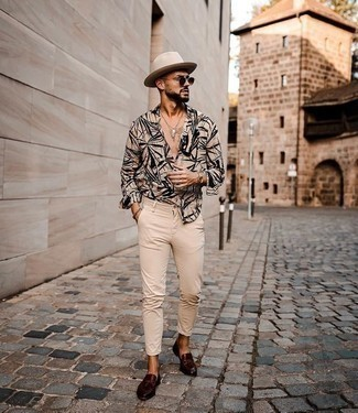 Burgundy Leather Tassel Loafers Outfits: Consider pairing a beige print long sleeve shirt with beige chinos if you wish to look casually stylish without putting in too much time. Let your outfit coordination skills truly shine by finishing off this ensemble with a pair of burgundy leather tassel loafers.