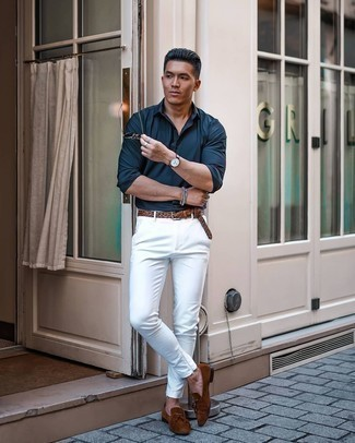 Navy Long Sleeve Shirt Outfits For Men: Reach for a navy long sleeve shirt and white chinos if you wish to look casually stylish without much effort. With footwear, go for something on the classier end of the spectrum and complete this outfit with brown suede tassel loafers.