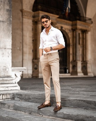 Beige Chinos with Brown Leather Tassel Loafers Outfits: Want to infuse your closet with some relaxed casual dapperness? Try pairing a white long sleeve shirt with beige chinos. On the fence about how to finish your outfit? Wear brown leather tassel loafers to rev up the classy factor.