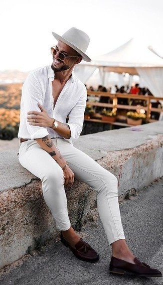 Dark Brown Leather Tassel Loafers Hot Weather Outfits: If you're planning for a sartorial situation where comfort is prized, this combo of a white linen long sleeve shirt and white chinos is always a winner. A pair of dark brown leather tassel loafers easily ups the style factor of any outfit.