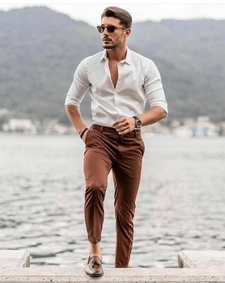 Brown Leather Tassel Loafers Outfits: Pair a white long sleeve shirt with brown chinos if you seek to look laid-back and cool without too much work. Brown leather tassel loafers will immediately lift up even your most comfortable clothes.