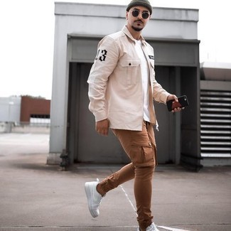 Beige Long Sleeve Shirt Outfits For Men: A beige long sleeve shirt and brown cargo pants make for the ultimate off-duty ensemble for any modern gentleman. Now all you need is a pair of white canvas low top sneakers.