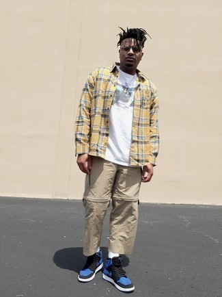 Khaki Cargo Pants Outfits: For a sharp look without the need to sacrifice on comfort, we like this combo of a yellow plaid long sleeve shirt and khaki cargo pants. Got bored with this ensemble? Let navy leather high top sneakers jazz things up.