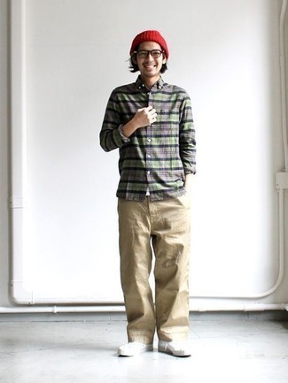 How to Wear a Red Beanie For Men: A grey plaid long sleeve shirt and a red beanie are a nice combo to add to your daily styling repertoire. Want to break out of the mold? Then why not add a pair of white canvas low top sneakers to the equation?