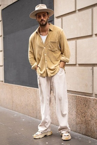 White Corduroy Chinos Outfits: Why not try pairing a tan long sleeve shirt with white corduroy chinos? As well as super functional, both pieces look amazing when worn together. If you need to easily dial down your look with one piece, why not go for a pair of tan athletic shoes?