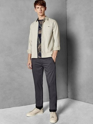 How to Wear Beige Leather Low Top Sneakers For Men: This cool and casual look is super straightforward: a beige long sleeve shirt and charcoal chinos. To add a more casual vibe to this outfit, complete this look with a pair of beige leather low top sneakers.