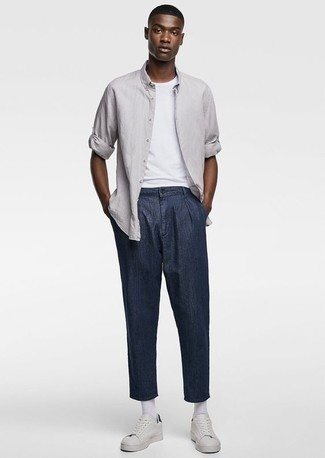 How to Wear a Grey Long Sleeve Shirt For Men: If you enjoy comfort dressing, make a grey long sleeve shirt and navy chinos your outfit choice. Complement this look with white leather low top sneakers to make a traditional outfit feel suddenly fun and fresh.