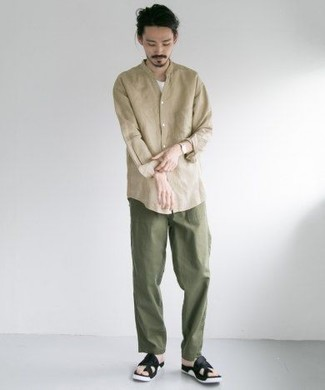How to Wear Black Leather Sandals For Men: This off-duty combo of a beige long sleeve shirt and olive chinos is very easy to put together without a second thought, helping you look on-trend and ready for anything without spending too much time rummaging through your wardrobe. To introduce a more casual feel to your look, complement your ensemble with black leather sandals.