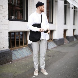 How to Wear a Black and White Print Canvas Tote Bag For Men: Go for a straightforward but at the same time cool and casual option in a white long sleeve shirt and a black and white print canvas tote bag. Want to break out of the mold? Then why not complement this outfit with beige canvas low top sneakers?