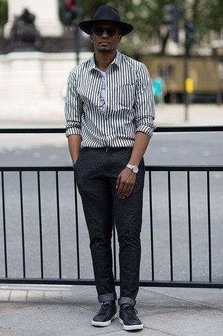 How to Wear a Hat For Men: A white and black vertical striped long sleeve shirt and a hat have become a go-to off-duty pairing for many style-savvy gents. And if you want to instantly bump up this ensemble with footwear, complete your outfit with black leather low top sneakers.