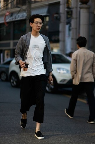 Black Leather Slip-on Sneakers Outfits For Men: Go for a grey chambray long sleeve shirt and black chinos for a seriously stylish, relaxed outfit. As for shoes, complement this look with black leather slip-on sneakers.