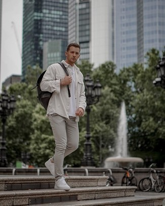Black Leather Backpack Outfits For Men: Team a white corduroy long sleeve shirt with a black leather backpack to pull together an interesting and casual outfit. To add a bit of zing to this outfit, throw in a pair of white leather low top sneakers.