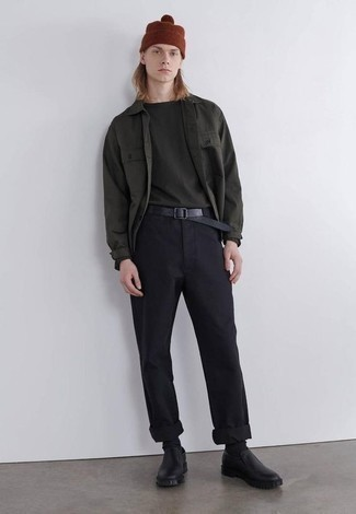Black Leather Loafers Outfits For Men: A dark green long sleeve shirt and black chinos are the kind of a winning casual look that you so awfully need when you have no time to dress up. Hesitant about how to finish off this outfit? Rock a pair of black leather loafers to spruce it up.