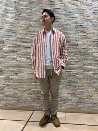 Khaki Chinos Spring Outfits: For a casual and cool getup, choose a white and red vertical striped long sleeve shirt and khaki chinos — these two items fit beautifully together. Take your outfit in a more sophisticated direction by rocking brown suede desert boots. Keep this outfit in your front hall wardrobe when warmer days are here, and we promise you'll save time crafting what to wear on more than one morning.