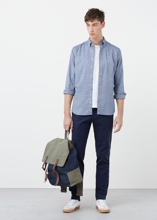 Light Blue Long Sleeve Shirt Outfits For Men: Combining a light blue long sleeve shirt with navy chinos is an on-point pick for a casual look. For something more on the cool and laid-back end to finish off your outfit, complete your ensemble with a pair of white leather low top sneakers.