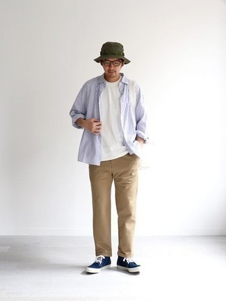 Sunglasses Outfits For Men: Infuse personality into your daily repertoire with a white and navy vertical striped long sleeve shirt and sunglasses. Finishing with a pair of navy and white canvas high top sneakers is a fail-safe way to introduce some extra fanciness to this ensemble.