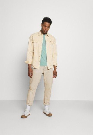 Beige Long Sleeve Shirt Outfits For Men: This off-duty combination of a beige long sleeve shirt and beige chinos comes to rescue when you need to look cool in a flash. White canvas low top sneakers are an effortless way to give a hint of stylish nonchalance to your outfit.