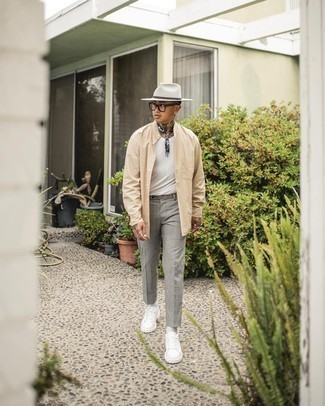 Beige Long Sleeve Shirt Outfits For Men: Fashionable and practical, this off-duty pairing of a beige long sleeve shirt and grey chinos provides with ample styling possibilities. Up your outfit by rocking a pair of white leather low top sneakers.