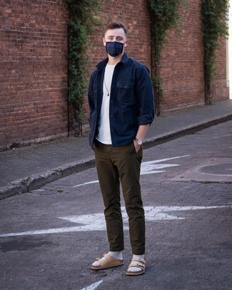 Dark Brown Chinos Outfits: Solid proof that a navy long sleeve shirt and dark brown chinos are amazing when married together in a laid-back look. Complete this outfit with tan leather sandals to bring an element of stylish casualness to this ensemble.